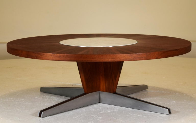 Vladimir Kagan Dreyfuss, NY, 1955 Black American walnut, marble, polished aluminum. Measures: 42 inch diameter x 14.5 inches tall. Outstanding condition. A rare circular cocktail table by Vladimir Kagan with polished aluminum blades with walnut