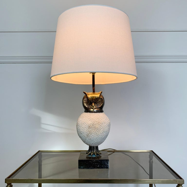 The coral owl lamp is an exceptionally rare and important piece of work made and signed by the pioneering Belgian artist Willy Daro Dating from the 1970s Comprising a body made from a single piece of natural coral with worked brass head and
