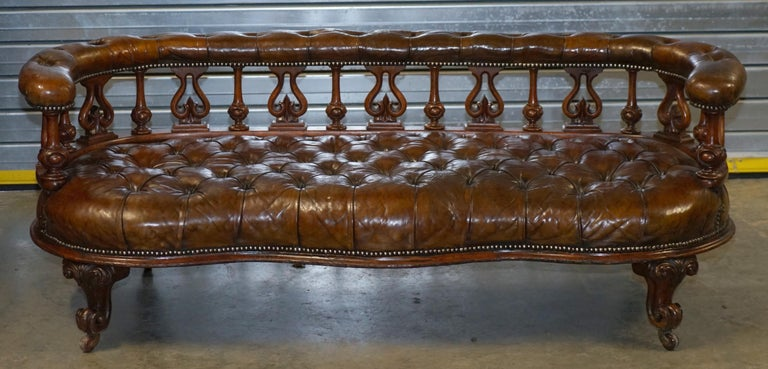 We are delighted to offer for sale this stunning handmade in England circa 1840 Victorian fully restored Chesterfield Whiskey brown leather salon sofa bench  This piece is just about as sculptural a sofa as you will ever find, the front line is