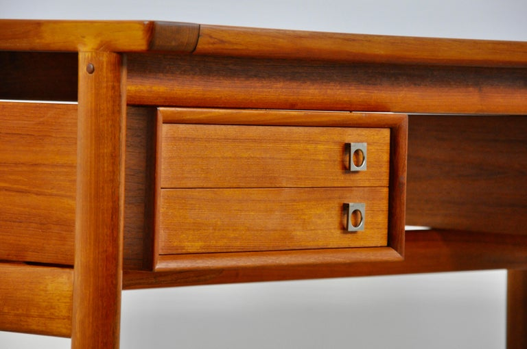 Teak desk with 4 drawers. Wear and tear due to time and the age of the desk.