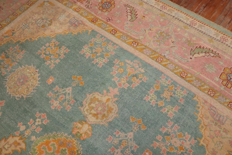 Early 20th Century Exhilarating Teal Pink Oversize Oushak Rug For Sale