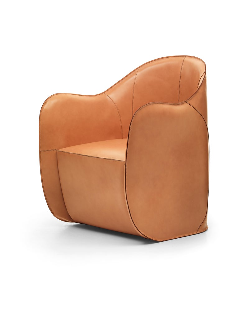 In this armchair and pouf set the cow-hide is both surface and structure. Like in an insect's exoskeleton there is no internal support structure. In both products the polyurethane body is covered with cow-hide panels that once sewn together become