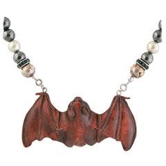 Exolette Agate Necklace Holding a Hand Carved Wooden Netsuke Bat