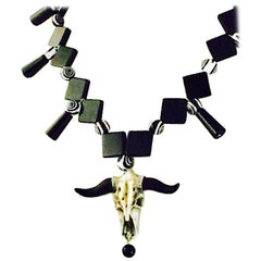 Exolette Cowgirl Black and White Beaded Necklace w/ Cast Stone Cow Skull Pendant