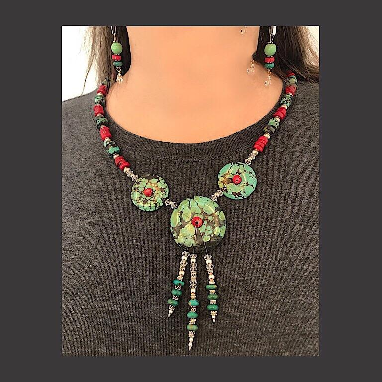 The figured turquoise red coral silver and green turquoise necklace and earring set is my own design. I first created a drawing, then accumulated the materials and assembled them into the piece. I used traditional materials and color combinations to