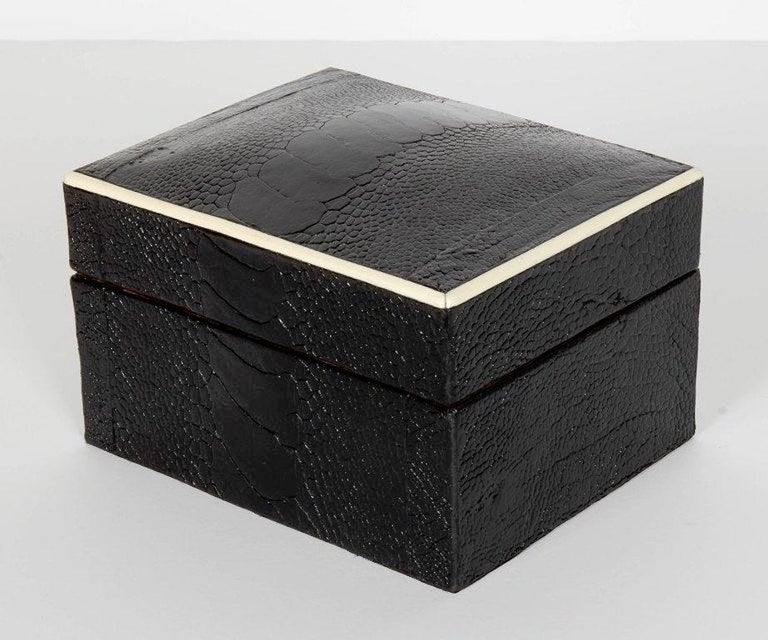Stunning organic modern decorative box wrapped in exotic ostrich leather with bone inlay trim. All handcrafted in fine leather hand dyed in ebony with palmwood interior. Great storage accessory for a desk, vanity, or coffee table. Box also available