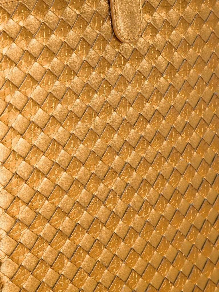 JUST GORGEOUS!  BRANDNEW BOTTEGA VENETA  GOLD INTRECCIATO NAPPA AYERS IPAD CASE  DESIGNED BY TOMAS MAIER  LIMITED EDITION - SOLD OUT IMMEDIATELY   Condition: Brandnew with tags and BOTTEGA VENETA dustbag   DETAILS:       A BOTTEGA VENETA signature
