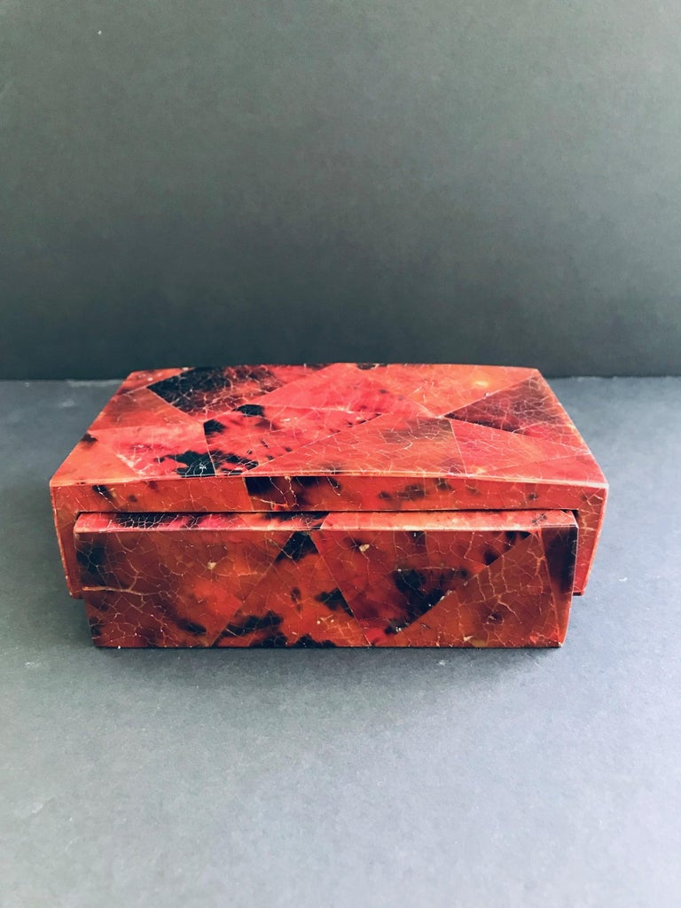 Organic Modern box or desk accessory in lacquered pen-shell. Hand-dyed in red and black with mosaic inlays throughout. Box features overlapping waterfall lid design with handcrafted palmwood interior. Signed R&Y Augousti on underside. Other matching