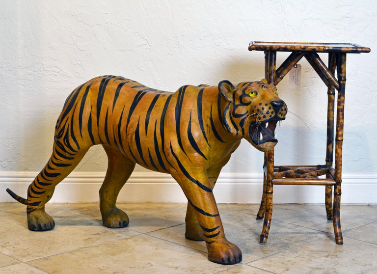 This epic 1960s leather wrapped sculpture of a Bengal Tiger with glass eyes, whiskers and teeth is most likely made in India for the English market. Being 55 inches long and 24 inches tall it makes a great exotic impression.