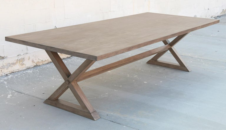 This walnut dining table is seen here in 113