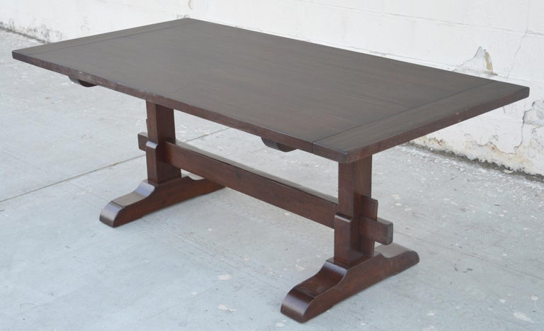 This walnut trestle table is seen here in 90