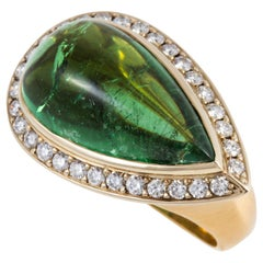 Exquisite 12.4 carat Green Tourmaline Cabochon Ring set in 18 karat Gold