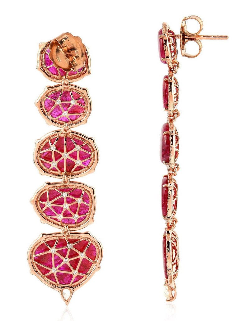 Handcrafted from 18-karat gold, this exquisite earrings is set with 29.98 carats of natural rubies and 2.93-carats of glimmering diamonds. The tiered drop rubies makes a great statement piece.   Please note that carat weights may slightly vary as