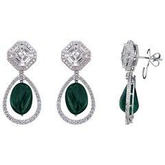 Exquisite 18 karat White Gold, Diamond and Drop Emerald Earring