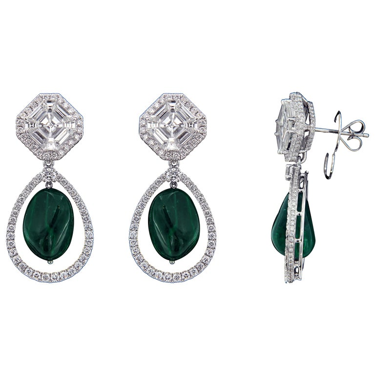 Exquisite 18 karat White Gold, Diamond and Drop Emerald Earring