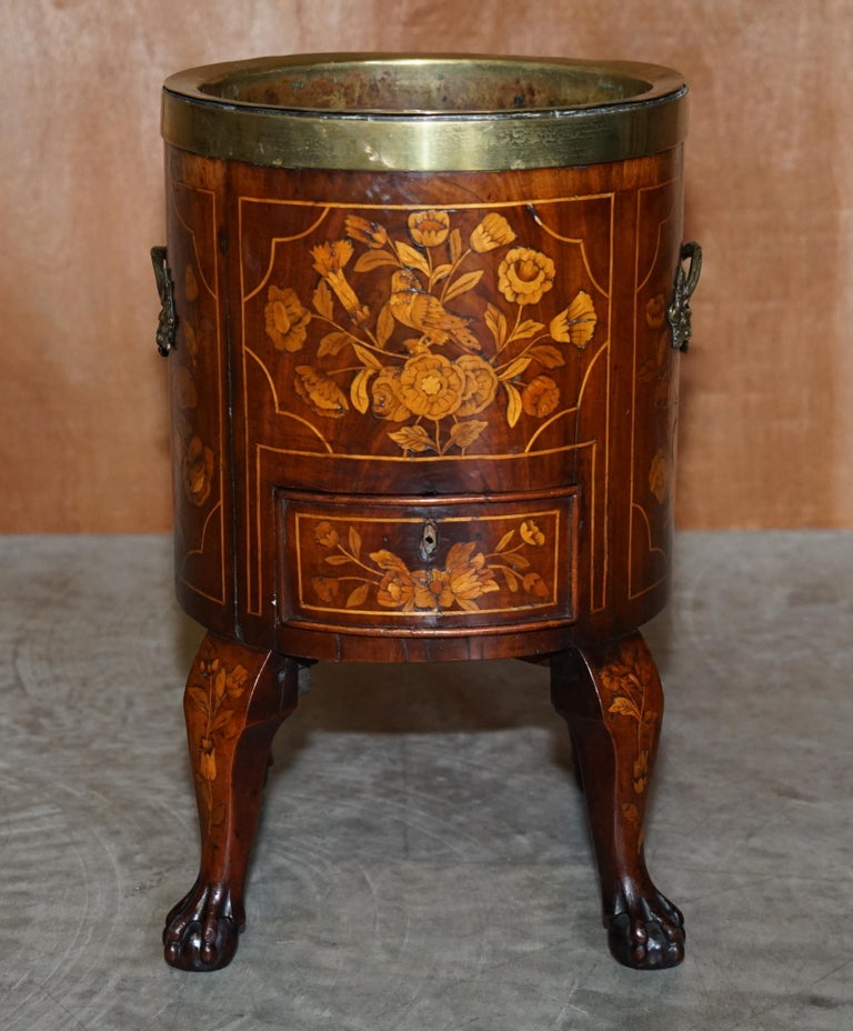 We are delighted to offer for sale this very rare circa 1800 Dutch inlaid wine cooler with original brass bucket and single drawer  A rare, collectable and good looking antique which fits well in any setting. This piece has exquisite marquetry