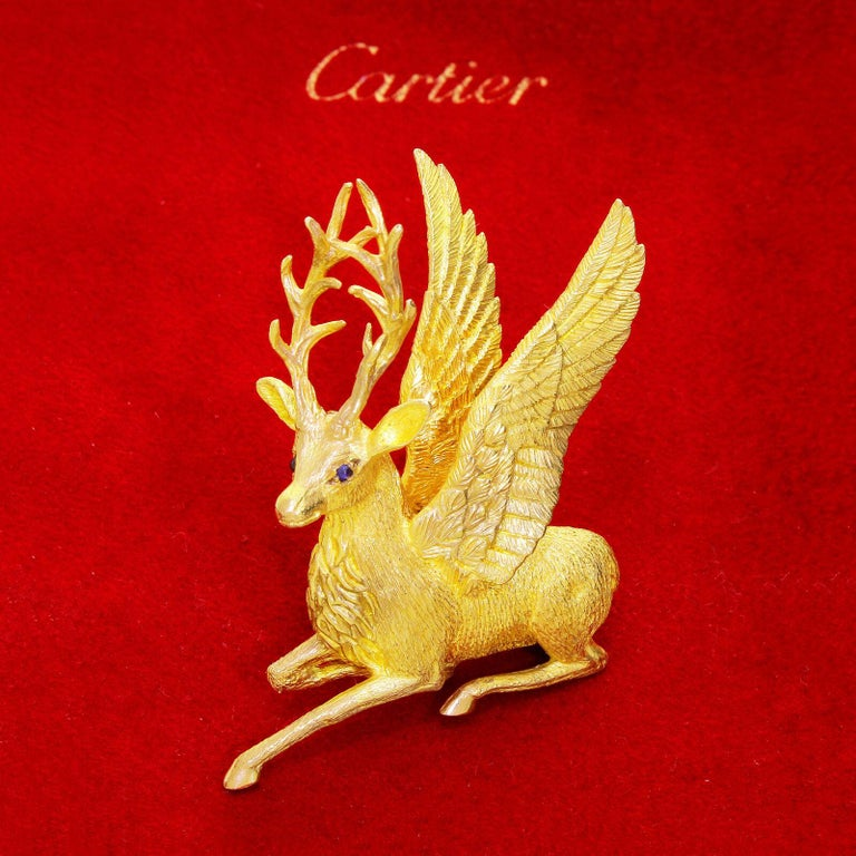 Exquisite majestic Cartier Mythological 18k yellow gold winged reindeer / deer stag from a private collection. The highest quality craftsmanship is evident throughout this piece. From the palm of the antler rack down to the shiny hooves, the