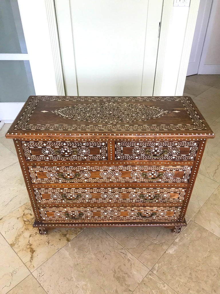 Midcentury Syrian chest of drawers with outstanding series of Moorish designs. All handcrafted by artisans comprised of reclaimed teak wood with bone, mother of pearl, and rosewood inlays throughout. The inlays create intricate geometric and floral