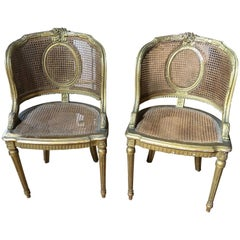 Exquisite Curved Pair of Louis XVI French Giltwood and Caned Armchairs
