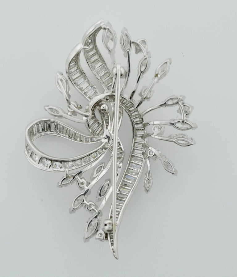 Exquisite Diamond Platinum Brooch Circa 1940's One Hundred and Twenty Three Round Brilliant, Marquise and Baguette Cut Diamonds weighing 8.00 carats approximately. Very Fine Quality   GH VVS-VS