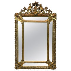 Exquisite French Carved Giltwood Putti Motif Cushioned Mirror, Paris, 1900