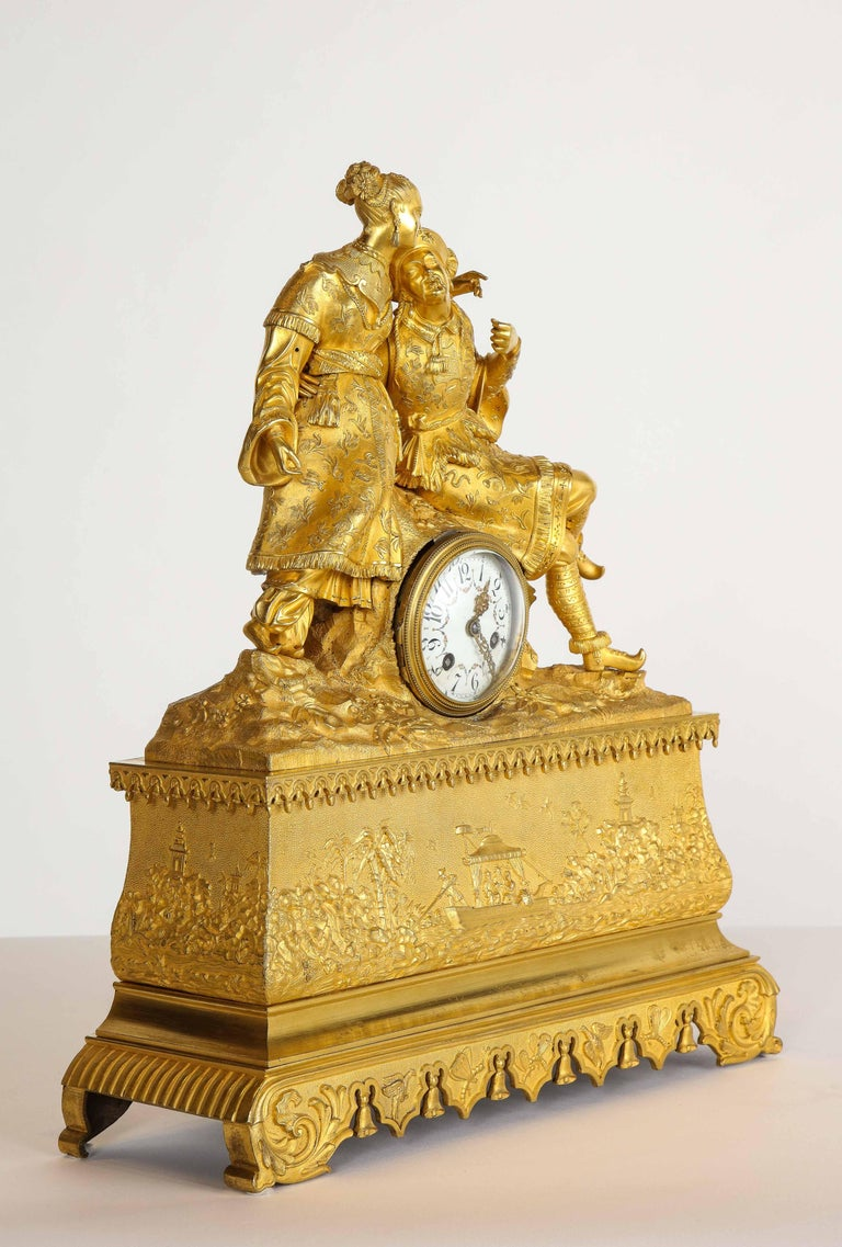 Exquisite French Charles X ormolu bronze chinoiserie figural table clock, early 19th century.  Depicting a Chinese, man and woman. The clock case depicting the China trade.  Very high quality ormolu. Very fine chasing. Fully detailed