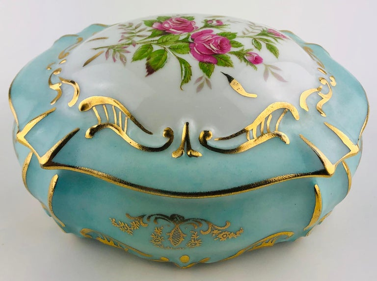 A truly exquisite French Limoges handcrafted and hand painted gold trimmed trinket /jewelry box or candy dish, circa 1930.  Bears the Limoges stamp. Glazed.  Measures: 5 7/8