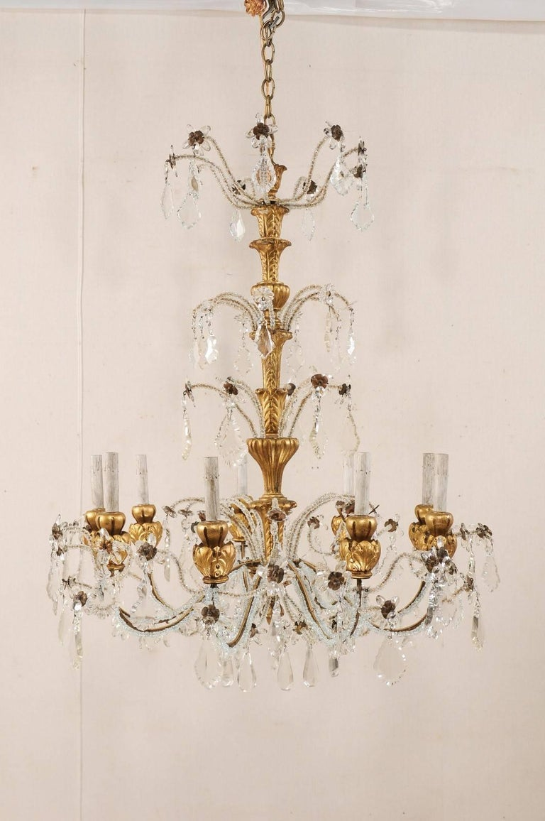 Beaded Exquisite Italian Vintage Gilded and Carved Wood Multi-Tiered Crystal Chandelier For Sale