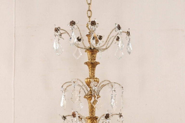 Exquisite Italian Vintage Gilded and Carved Wood Multi-Tiered Crystal Chandelier In Good Condition For Sale In Atlanta, GA