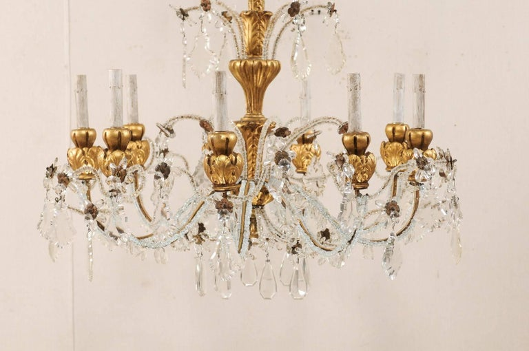 Exquisite Italian Vintage Gilded and Carved Wood Multi-Tiered Crystal Chandelier For Sale 1