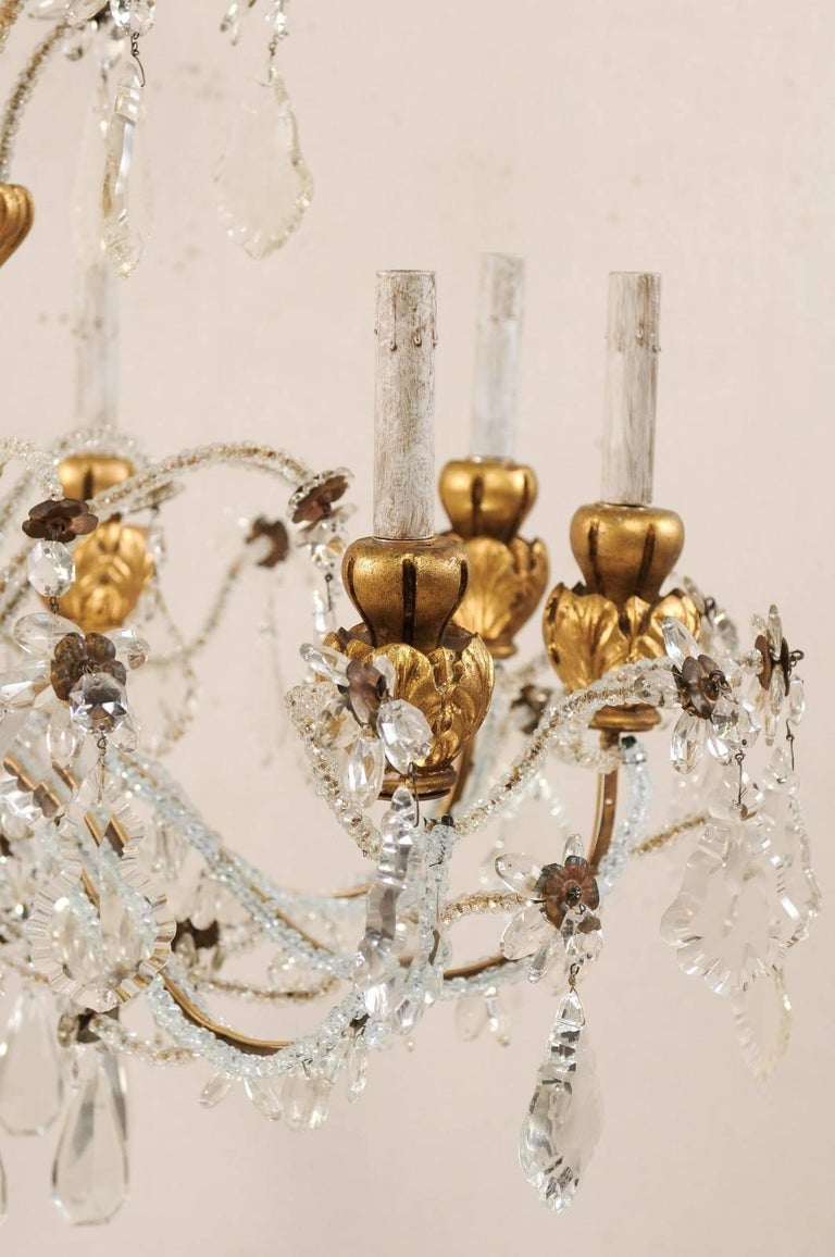 Exquisite Italian Vintage Gilded and Carved Wood Multi-Tiered Crystal Chandelier For Sale 2