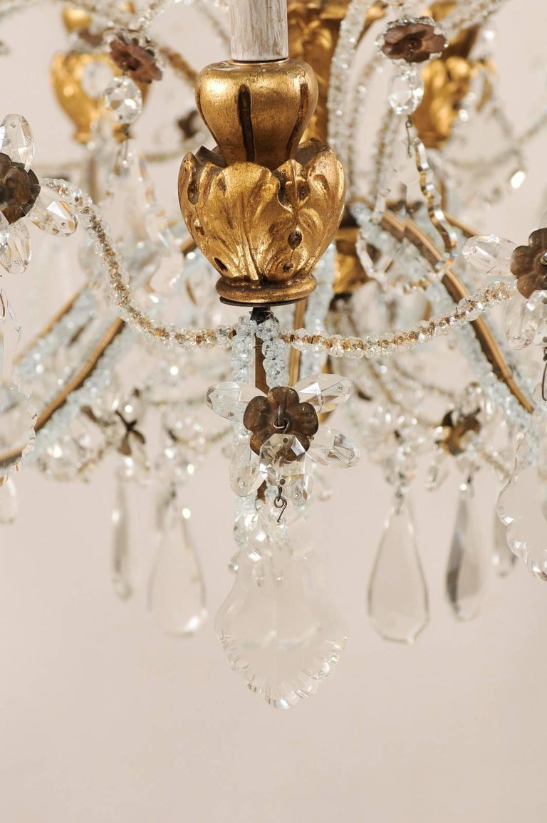 Exquisite Italian Vintage Gilded and Carved Wood Multi-Tiered Crystal Chandelier For Sale 3