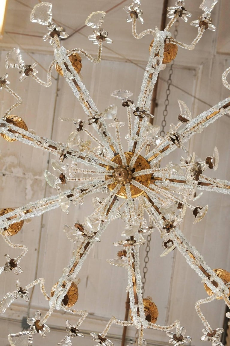 Exquisite Italian Vintage Gilded and Carved Wood Multi-Tiered Crystal Chandelier For Sale 4