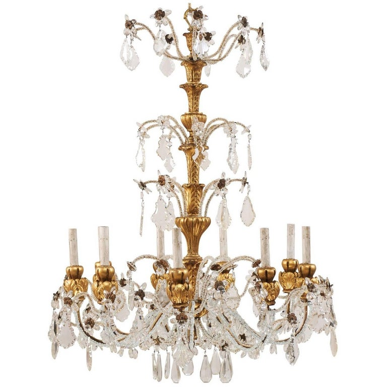 Exquisite Italian Vintage Gilded and Carved Wood Multi-Tiered Crystal Chandelier For Sale