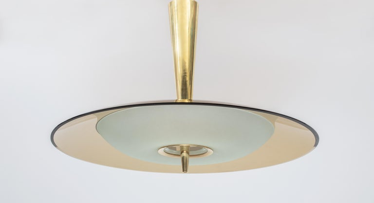 Max Ingrand (1908-1969) for Fontana Arte    A stunning modernist chandelier by lighting pioneer Max Ingrand for Fontana Arte, with a circular convex satin-finish glass bowl and large curved rose-colored glass shade joined by a significant tapering
