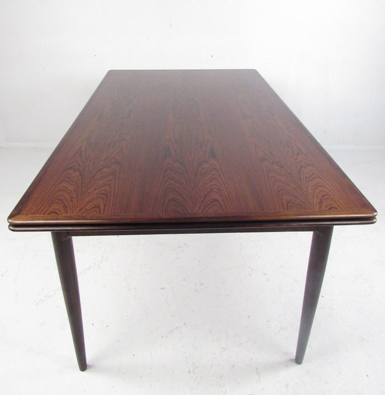Exquisite Midcentury Danish Rosewood Draw Leaf Dining Table For Sale 1