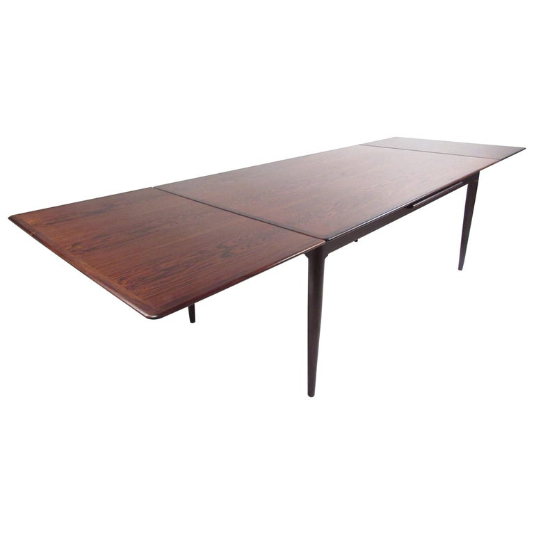 Exquisite Midcentury Danish Rosewood Draw Leaf Dining Table For Sale
