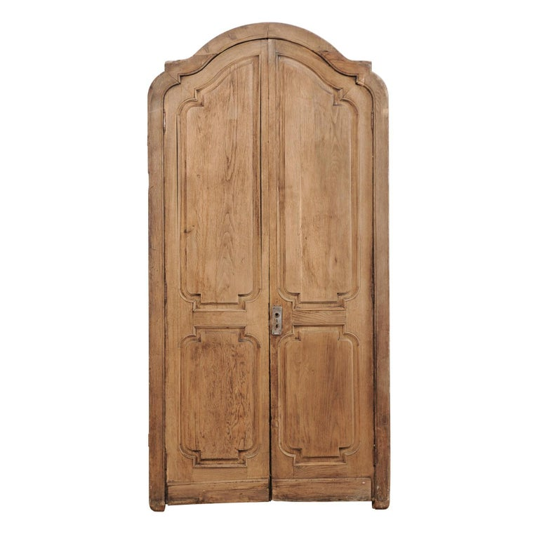 Exquisite Pair of Arched 19th Century Spanish Carved Wood Doors with Casing For Sale
