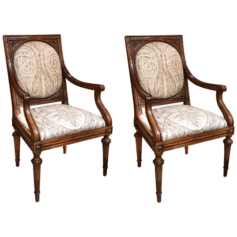 Exquisite Pair of Italian Neoclassical Carved Walnut Upholstered Armchairs For Sale
