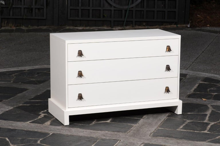 This majestic commode has undergone a meticulous complete restoration. The chest may be re-lacquered in another Ben Moore color in advance of shipment, if another color is desired.  There are a pair of these rare chests available.  Hardware may be