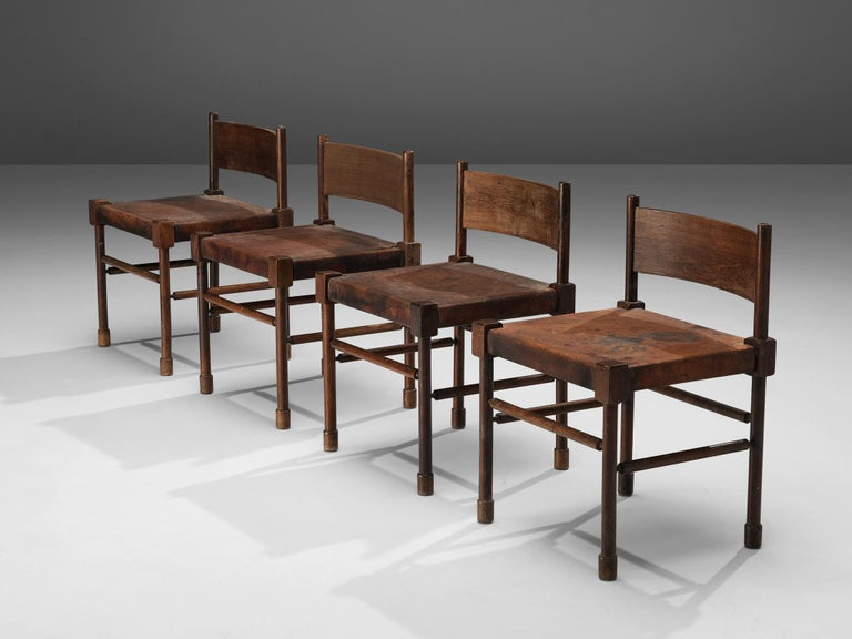 Set of 4 side chairs, stained wood, patinated leather, Europe, 1940s  Rare side chairs with sculpted frame in stained wood and leather seats. What makes this design so unique is the way the designer played with proportions and shapes. The detailed