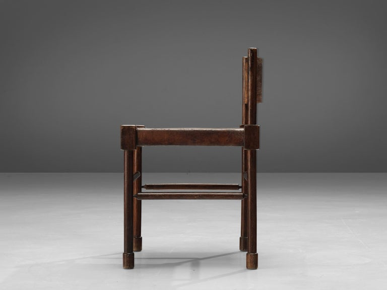 Side chair, stained wood, patinated leather, Europe, 1940s  Rare side chair with sculpted frame in stained wood and leather seat. What makes this design so unique is the way the designer played with proportions and shapes. The detailed carved