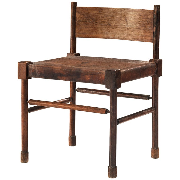 Exquisite Side Chair in Original Patinated Leather and Stained Wood For Sale