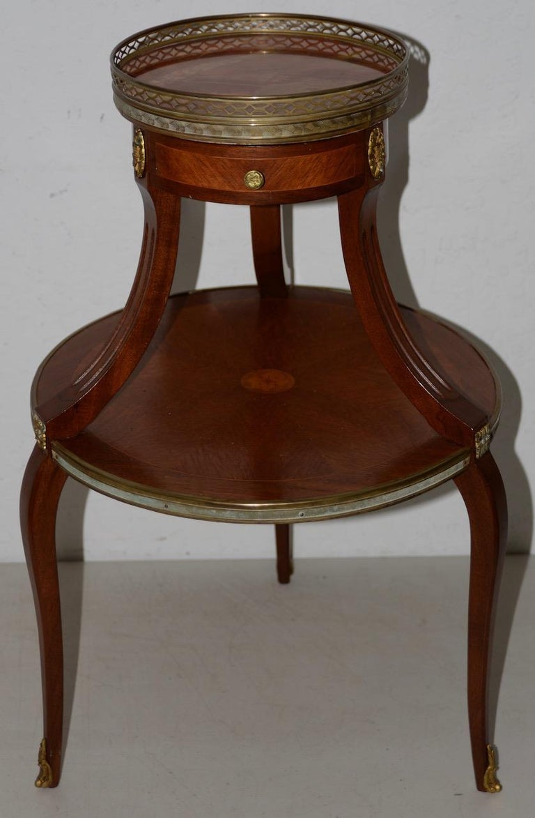 Exquisite two-tier Italian mahogany & marble side table, circa 1910  Beautiful side table with lovely marble top, brass mounts and Marquetry inlay.  The lower table with marquetry work measures 17