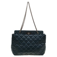 Exquisitely crafted from aged leather, this Reissue tote from Chanel bears their
