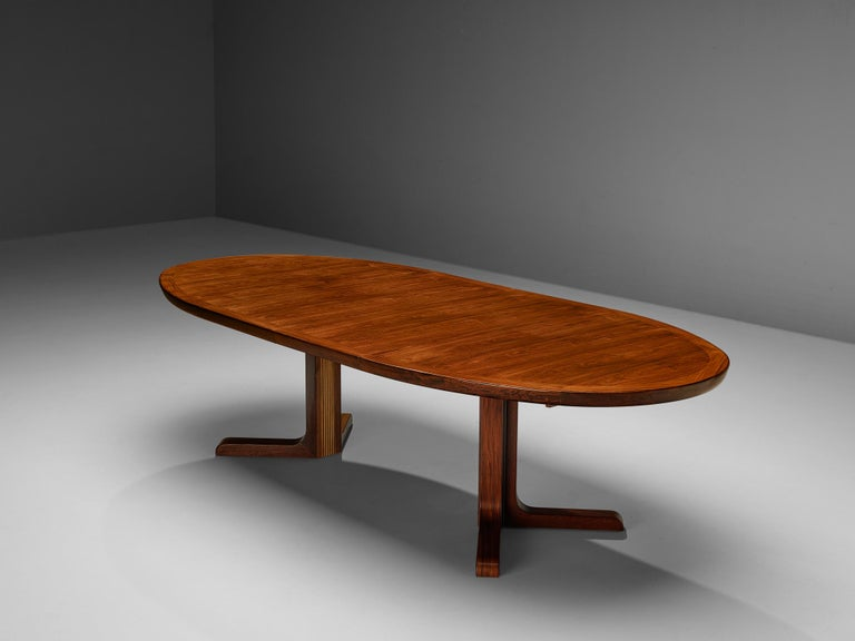 Extendable dining table, teak, Denmark, 1950s  With two extra leaves this table can be extended form a small, round size to a large, oval format. The table top is veneerd in the matter of parallel lines. With the natural grains the top gets
