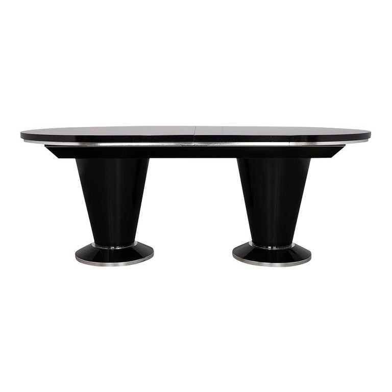 This Vintage Mid Century Modern Extendable Dining Table has been newly restored, made out of solid wood, and stained a rich black & silver color combination with a newly lacquered finish. This Oval Conference Table features an additional leaf that