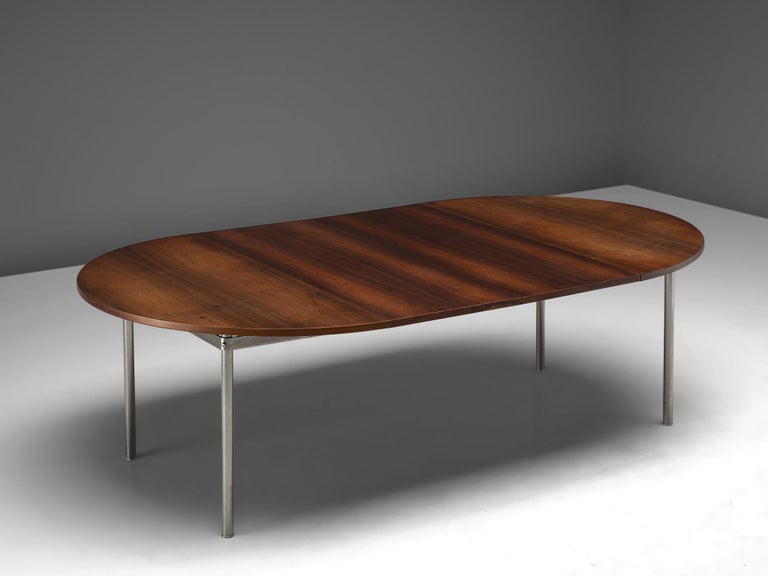 Hans Wegner for Andreas Tuck, extendable dining table, rosewood met metal, Denmark, 1961.