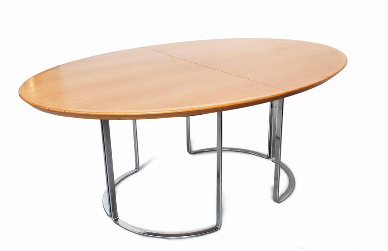 Extendable dining or conference table by Horst Brüning, Germany, 1970s.This is truly a stunning table with many options, there are two walnuts contrasting leafs the table can be extended to 3 meters it has an oval shape that is preserved with the