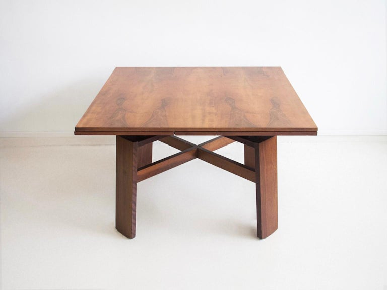 Square walnut table, model 612, designed by Silvio Coppola in 1964. Manufactured by Bernini in Italy. Extendable into a large dining table.  Literature: G. Gramigna, Repertorio del Design Italiano 1950-2000 per l'Arredamento Domestico, Torino